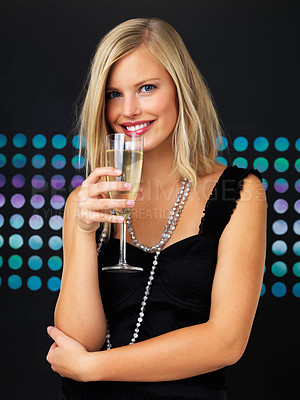 Buy stock photo Happy woman posing with champagne flute and looking at you