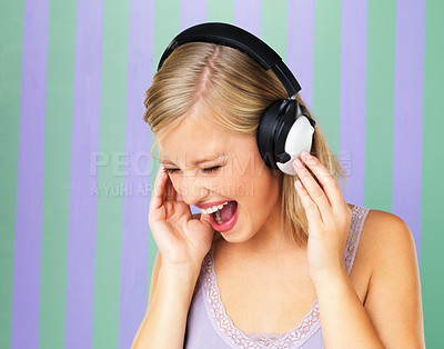 Buy stock photo Portrait of pretty woman singing while listening to headphones