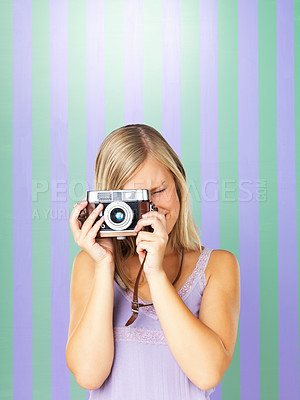 Buy stock photo Pretty woman focusing lens on vintage camera