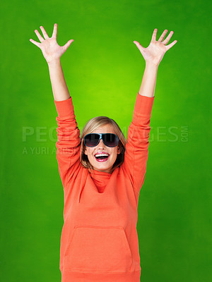 Buy stock photo Portrait of pretty woman in sunglasses extending arms with excitement