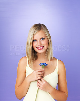 Buy stock photo Portrait of beautiful woman holding daisy
