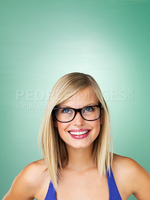 Buy stock photo Closeup of young girl in glasses smiling on green background