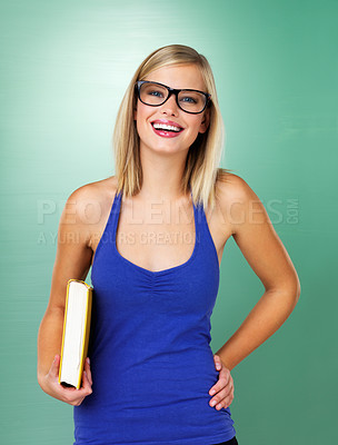 Buy stock photo Young woman in glasses holding book and smiling