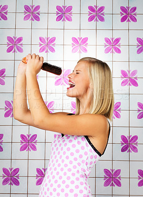 Buy stock photo Pretty woman holding up brush and singing into it