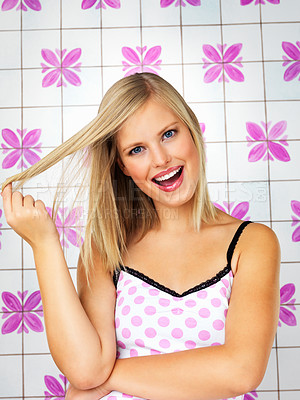 Buy stock photo Pretty blonde woman holding hair in flirtatious manner
