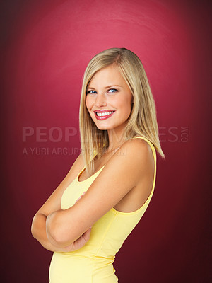 Buy stock photo Side view of pretty woman smiling with arms crossed