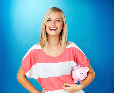 Buy stock photo Pretty woman holding piggybank under arm