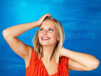 Buy stock photo Pretty woman posing with hands in hair and looking up
