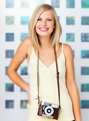 Buy stock photo A cute young woman standing with her vintage and smiling adorably