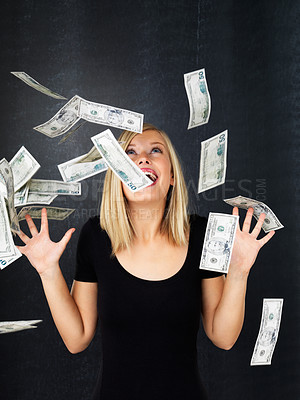 Buy stock photo Woman standing with arms up in excitement as money falls