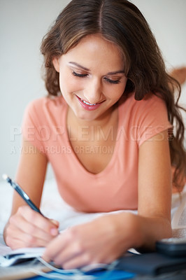 Buy stock photo Girl lying down on bed studying