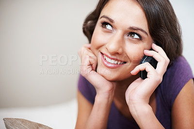 Buy stock photo Happy girl musing while on the phone