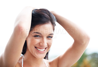 Buy stock photo Closeup portrait of a charming young girl smiling against bright background