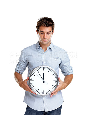 Buy stock photo Portrait of a handsome young man holding a wall clock in hand on white background