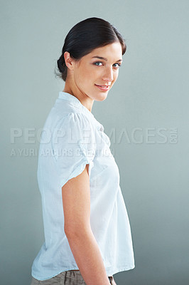 Buy stock photo Portrait of a beautiful young female model standing against grey background