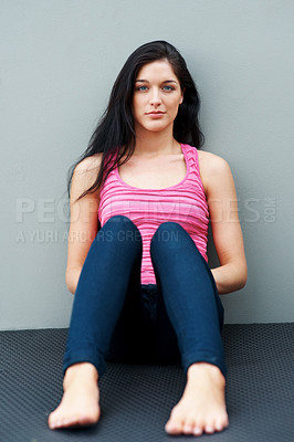 Buy stock photo Portrait of an attractive young female sitting relaxed on the mat