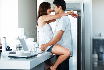 Buy stock photo Portrait of an affectionate young couple having a moment in kitchen at home - Indoor