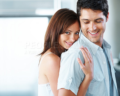 Buy stock photo Portrait of a pretty young woman hugging her boyfriend from behind - Copyspace