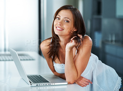 Buy stock photo Portrait of a happy young woman standing in her nightie with her laptop at home  - copyspace
