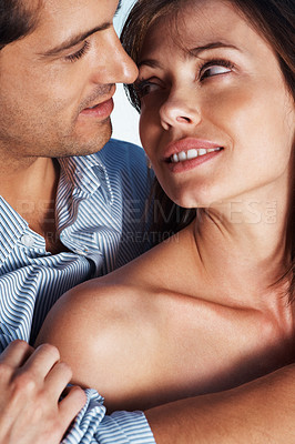 Buy stock photo Closeup portrait of an affectionate young couple looking at each other