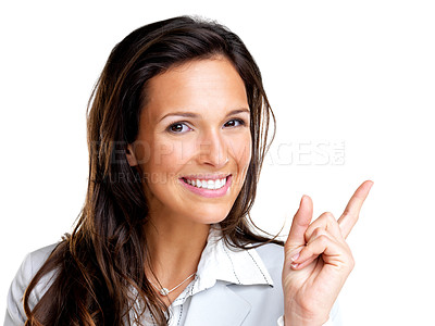 Buy stock photo Closeup portrait of a happy young business woman pointing at something interesting against white background
