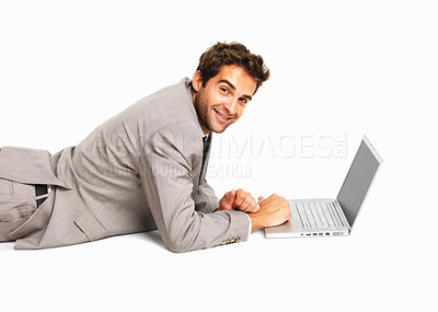 Buy stock photo Happy business man with laptop lying on white background