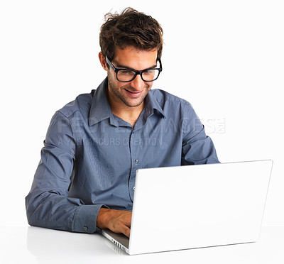 Buy stock photo Happy man in glasses working using laptop on white background
