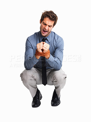 Buy stock photo Furious business man with his hands tied with rope on white background