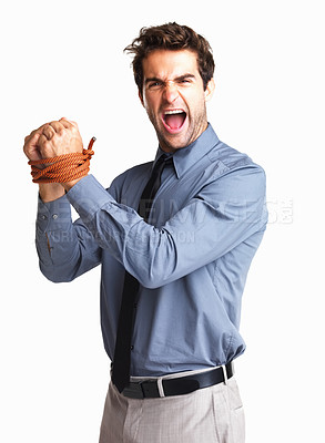 Buy stock photo Angry executive standing with his wrists bound