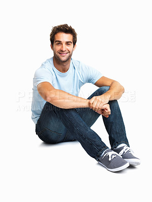 Buy stock photo Casually dressed man sitting on the floor