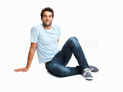 Buy stock photo Happy man sitting on the floor relaxing