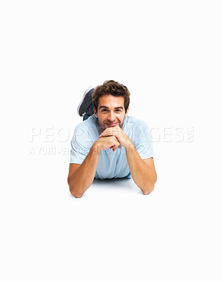Buy stock photo Handsome man lying on the floor resting face on hands