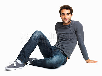 Buy stock photo Handsome young man sitting on the floor