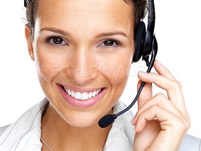 Buy stock photo Closeup portrait of a happy young female call centre employee smiling with a headset on white background