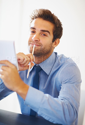 Buy stock photo Young executive holding pencil and notepad looking at you