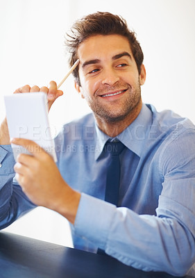 Buy stock photo Closeup portrait of smiling business man with pencil and notepad looking away