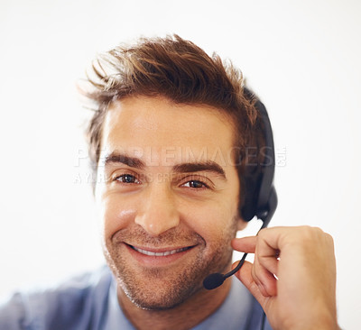 Buy stock photo Closeup portrait of young call center executive wearing headphones and smiling