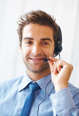 Buy stock photo Closeup portrait of young customer executive wearing headset and smiling