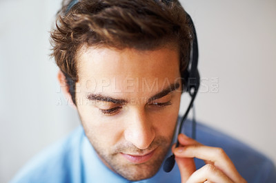 Buy stock photo Closeup portrait of male helpdesk person assisting over phone with headset