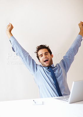 Buy stock photo Young business man stretching hands in front of laptop