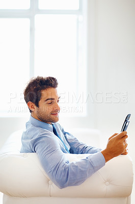 Buy stock photo Junior executive sitting and looking at phone