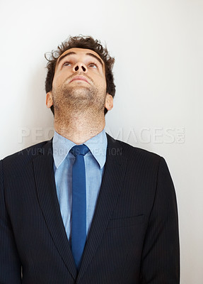 Buy stock photo Businessman indoors looking up