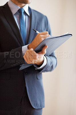 Buy stock photo Businessman writing on clipboard