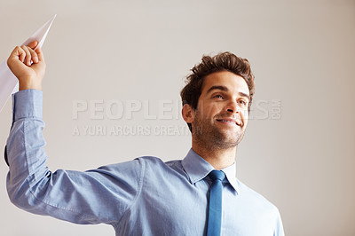 Buy stock photo Businessman holding paper airplane indoors