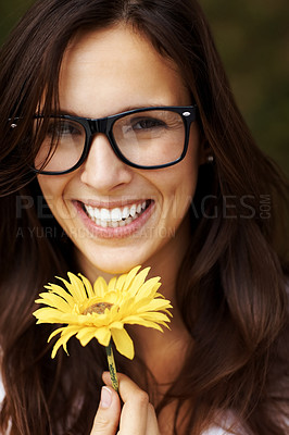 Buy stock photo Closeup portrait of lovely young girl wearing glasses smiling with a yellow flower