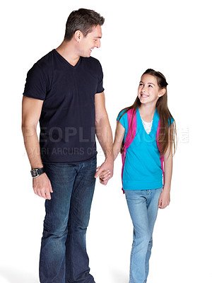 Buy stock photo Portrait of a cute little girl going to school with her father against white background