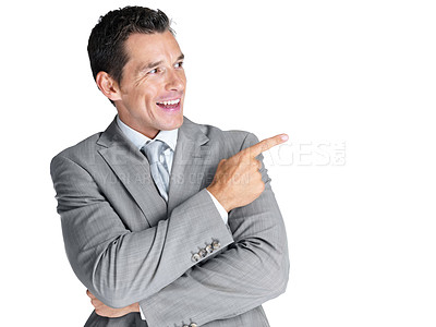 Buy stock photo Portrait of a successful young business man pointing at something interesting against white background