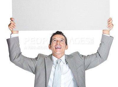 Buy stock photo Portrait of a smiling young business man holding a blank billboard above his head on white background