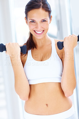 Buy stock photo Portrait of fit young woman exercising with free weight dumbbell