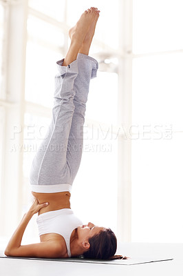 Buy stock photo Portrait of healthy young woman doing a yoga pose with feet in the air